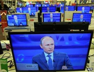 Vladimir Putin's face on TV screens in a Moscow shop, 25 April