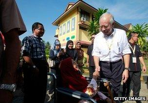 Najib Razak greets a voter in Pekan, Malaysia, 5 May