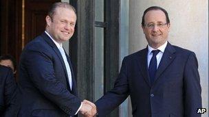 Maltese Prime Minister Joseph Muscat and French President Francois Hollande