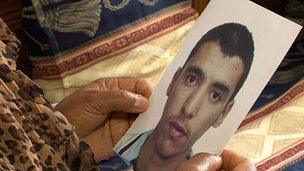 A Tunisian mother holds a photograph of the son who has joined the rebels to fight in Syria