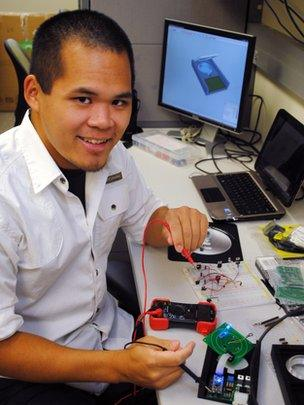 Bennett Kim Ng works on circuit boards
