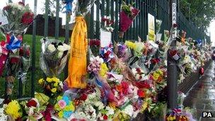 The scene at the junction of Artillery Place and John Wilson Street which has become a shrine to Drummer Lee Rigby
