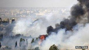 Smoke rises after fighting near the Quneitra crossing on the Golan Heights