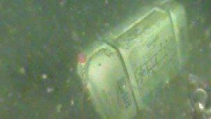 Life raft on seabed