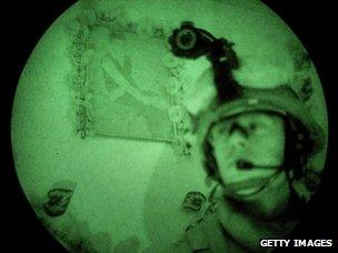 Soldier in night vision goggles