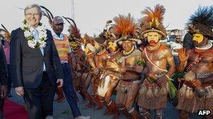 Australian Prime Minister Kevin Rudd (left) arrives in Port Moresby on 14 July 2013