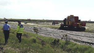 Police at Monivea turf-cutting