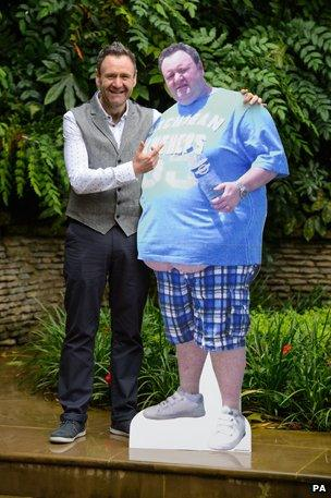"""Thomas McIntyre, with cardboard cut-out of former """"fat"""" self"""