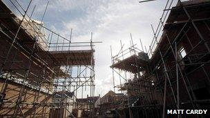 Newly-built homes with scaffolding on them