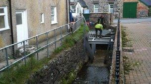 New metal screens are fitted on the culvert to stop the Nant Barrog stream getting blocked