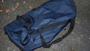 Police believe the device was moved in this blue holdall