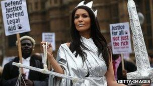 A protestors dressed as Lady Justice during a demonstration in support of Legal Aid near Parliament on May 22, 2013 in London