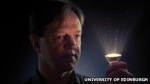 Prof Harald Haas holding LED bulb