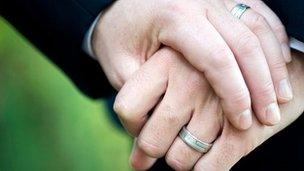 Two hands with wedding rings on them
