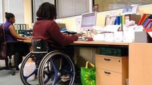Disabled woman in office