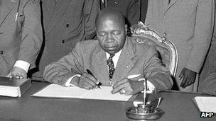 Gabonese Prime Minister and future President Leon M'ba pictured in 1960 during the signing of an agreement with France