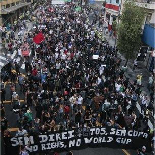 People take part in a protest in Sao Paulo, Brazil, on January 25, 2014.