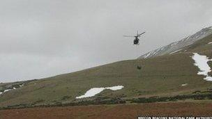 Airlift delivering brash to repair land