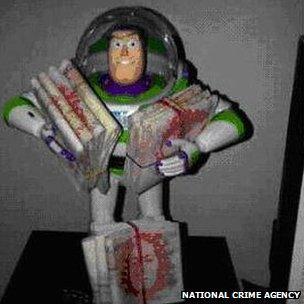 Buzz Lightyear model with money