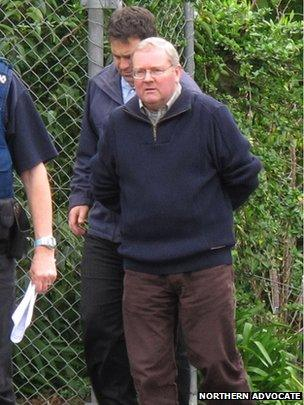 Michael Harris is led to Kaitaia police station on 10 September 2014
