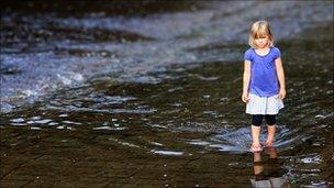 girl walking by stream