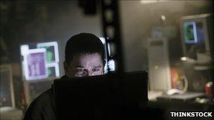 man behind computer