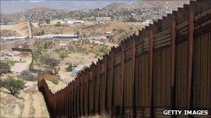 A fence separating the US state of Arizona and Mexico
