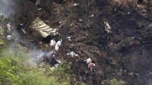 Rescue workers look for survivors at the crash site