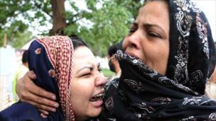 Pakistani women cry in Islamabad