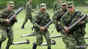 Colombian soldiers carry mortars seized in Cali said to belong to Farc rebels