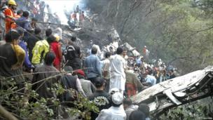 Rescuers search the crash site
