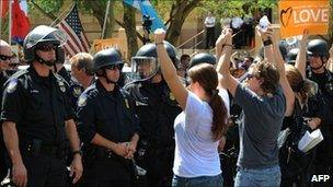 Protesters face-off with police in Phoenix, Arizona, 29 July