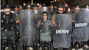 "Sheriff""s deputies form a defensive line outside the office of Sheriff Joe Arpaio, 29 July"