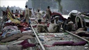 People sheltering on railway line in Nowshera, Pakistan (1 August 2010)