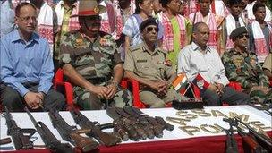 Indian police with captured Ulfa weapons