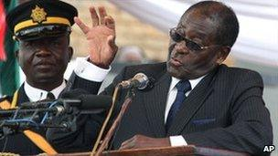 Zimbabwean President Robert Mugabe speaks at his sister's funeral, 1 August
