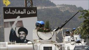 Unifil vehicles patrol in front of a picture of Hezbollah leader Hassan Nasrallah in the southern border village of Adaisseh, Lebanon, August 4, 2010.