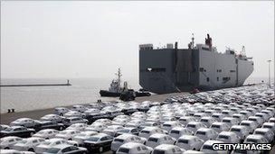 VW cars wait to get loaded onto transport ships at the Volkswagen car factory Emden