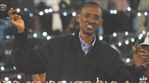Rwandan President Paul Kagame waves to surpporters during an celebration rally at the Amahoro stadium on Monday 10 August