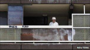 A man on the balcony of the Heygate estate