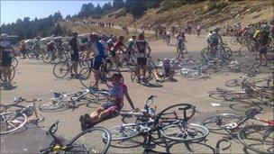 Men who have collapsed with exhaustion on the climb up Ventoux