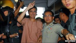 Korkaew Pikulthong, one of the leaders of the red-shirt movement, arrives for a hearing at Bangkok Criminal Court