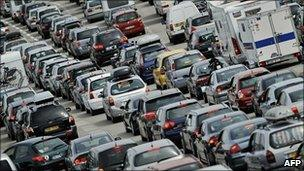 Cars queue at a toll on the A7 motorway in Vienne, eastern France