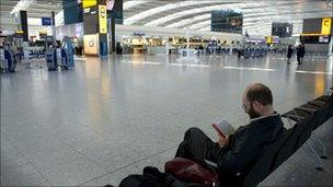 Man waiting at Heathrow airport April 2010
