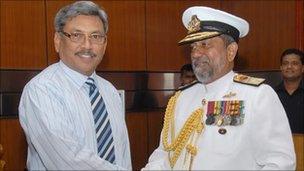Gotabhaya Rajapaksa (left) with a navy commander
