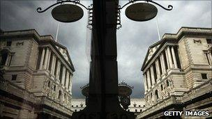 Bank of England reflected in a shop window