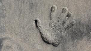 Woman's handprint on a beach in San Diego, California
