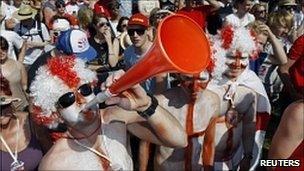 A man blowing a vuvuzela