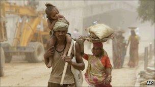 Labourers at the Indira Gandhi stadium in Delhi on Wednesday 18 August 2010