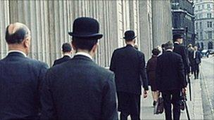 City gents in bowlers and overcoats outside Bank of England